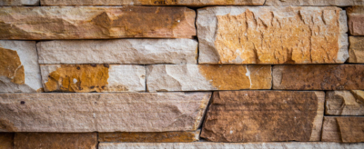 Detail photo of complex wall construction. Stone as Teacher.